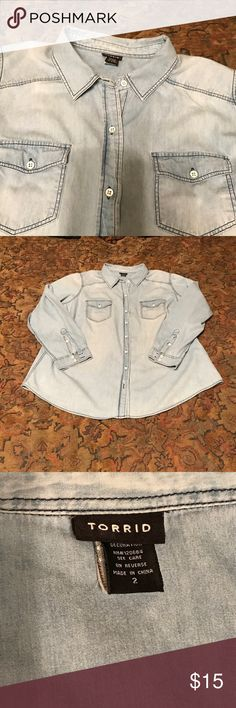 """Torrid Denim Shirt Comfy Torrid Denim Shirt will be your go to wear for weekends.  Made of soft 100% cotton, the shirt measures 24"""" seam to seam at the bust and 28"""" in length. torrid Tops Button Down Shirts"""