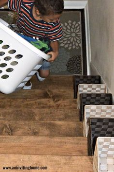 child+carrying+laundry+baskets+up+stairs.jpg 789×1,184 pixels