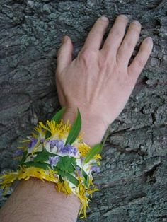It is what it looks like, a tape bracelet with the sticky side up ready to catch beautiful things from a nature walk.