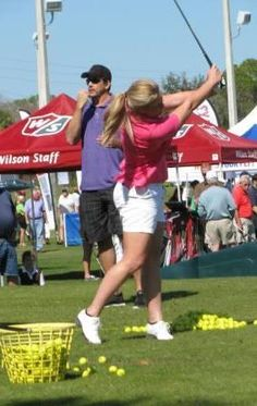 Brittany Lincicome of the LPGA demonstrates her swing to a very large group of spectators at Golfest 2013!
