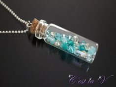 Caribbean Dreams  Glass, crystal, and sterling silver necklace. Includes a glass bottle with cork, Swarovski crystals, and sterling silver chain.    $45     Etsy Store: https://www.etsy.com/ca/shop/cestlavjewelry?ref=hdr_shop_menu