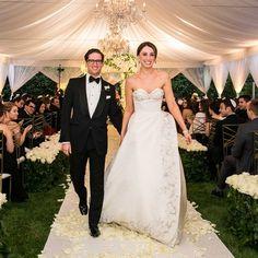 Bride & Groom Recessional in Tent |   Photography: Samuel Lippke Studios. Read More:  http://www.insideweddings.com/weddings/romantic-jewish-wedding-with-lush-ivory-flowers-rose-gold-details/790/
