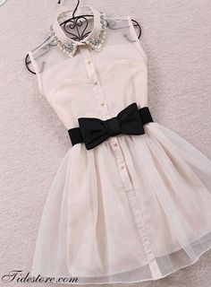 this dress is white it has Perls and a bow tie you can wear it any were .