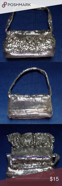 "Jazzy silver mesh purse Add some pizazz to your life with this glitzy silver handbag. Ruffled metal mesh (inspired by Whiting and Davis) makes a shiny sparkle effect. Purple satin lining, zip closure, flat bottom, and thick handle. Super fun and festive. Barely used. Measures 8"" x 4"" x 1.5"", 7"" drop. Bags Mini Bags"
