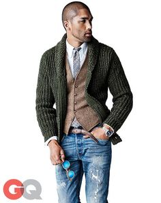 Team a hunter green shawl cardigan with blue distressed jeans for a comfortable outfit that's also put together nicely.  Shop this look for $193:  http://lookastic.com/men/looks/sunglasses-jeans-watch-belt-longsleeve-shirt-tie-waistcoat-shawl-cardigan/5360  — Blue Sunglasses  — Blue Ripped Jeans  — Silver Watch  — Brown Leather Belt  — White Longsleeve Shirt  — Grey Plaid Tie  — Brown Wool Waistcoat  — Dark Green Shawl Cardigan