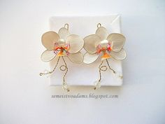 Wire white orchid (earrings) with nail polish by semeistvoadams.blogspot.com