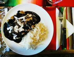 Alicia's Enmolladas____chicken tacos, mole negro and rice____vegetarian version for me : lentil tacos, mole negro, rice.  S U P E R L A T I V O!!!
