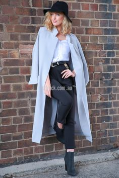 Constantina Tailored Trench in Grey $35.00  Body lengthening and slimming, the Constantina Tailored Trench is a great full length basic coat. This is an open front coat, tailored with a split in the back and oversized pockets has a slightly boxy body with petite, slim fit through the shoulders and arms.  Slimming and gorgeous, Constantina will give you that edge contemporary edge in a timeless style.