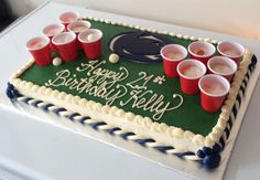 21st Birthday @ PSU - Beer Pong 21st Birthday Celebration Cake. Mini red solo cups are filled with a lemon jello shot with a foamy top to look like beer. PSU logo, braids and paws were made from modeling chocolate. Inside it is blue velvet (same as red only blue!).