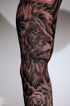 Tattoo Artist: Juncha !! Realism Lion tattoo... Ridiculously impressive Black and gray gallery. Take a look at how this Master tackles 3-dimensional statue tattoos. 3D. Roses. Grey. Repin & Like plz. Thanks . Also listen to Noel's songs. Noelito Flow.