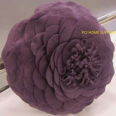 Purple felt flower cushion...one of these would be lovely.