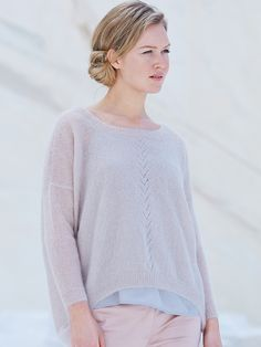 Carnation - Knit this women's relaxed fit sweater from the Simple Shapes Kidsilk Haze Collection, a design by Marie Wallin using the luxurious yarn Kidsilk Haze (mohair and silk). With a pretty lace stitch detail down the middle front, longer back hem, boat neck and full length straight cast off sleeves, this knitting pattern has a two star difficulty rating.