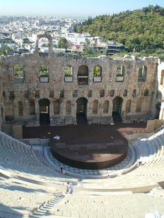 """Athens--This is looking down from on top of the Acropolis. I looked down and whispered to my friend """"we are in Greece but that is a Roman theater because the stage is a partial circle with a wall, instead of a full circle..."""" (I had just taken theater history). Less than a minute later the guide pointed down and said """"Herodian's Theater here was remodeled by the Romans when they were here in [some year]..."""" :) Point for me. :)"""
