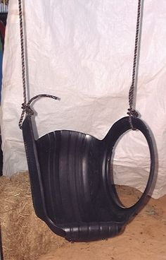 plain old  tyre swing. I had these as a kid :) Down side - you get black scuff marks from the tyres...