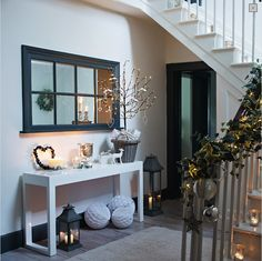 Love the mirror! -decorated entryway