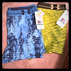 Under Armor Spandex Bundle Large Brand new with tags. $60 value. 1 blue pair & 1 green pair. Under Armour Shorts