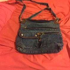 Denim shoulder bag. Used but still in pretty good condition. Really spacious, just not really my style. I'm open to offers, comment for additional pics! Bags