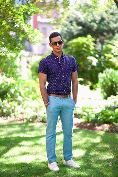 Busy days call for a simple yet stylish outfit, such as a navy and white polka dot short sleeve shirt and aquamarine casual pants. White low top sneakers are a nice choice to complete the look.   Shop this look on Lookastic: https://lookastic.com/men/looks/short-sleeve-shirt-chinos-low-top-sneakers/11372   — Dark Brown Sunglasses  — Navy and White Polka Dot Short Sleeve Shirt  — Brown Leather Belt  — Gold Bracelet  — Aquamarine Chinos  — White Low Top Sneakers