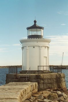 The Portland Breakwater Light is a small lighthouse in South Portland, Maine. The lighthouse's flashing red beacon helped guide ships from Casco Bay through the entrance to Portland Harbor.