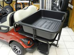 It's a rear flip seat. No, it's a rear cargo bed. No, it's BOTH! This poly rear cargo bin is specially designed to work with the Elite Aluminum 2-in-1 rear flip seat. So it slides over and and locks into place on the safety rails, so no additional straps or tie-downs are needed. In stock now for $149 each (the bin, not the seat). #customgolfcar #cargobin #rearflipseat #PES #Vandalia Yamaha Golf Carts, Electric Golf Cart, Custom Golf Carts, Golf Cart Accessories, Golf Cart Batteries, Hot Rides, Camper Ideas, Locks, Transportation