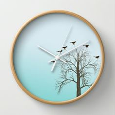 Tree with Birds Wall Clock by Zen and Chic - $30.00. So pretty. But I am numeral-dependent, so I would probably do a version of this with dainty white hash marks at the hour positions of the bezel/frame—or maybe tiny bird cutouts in white around the exterior?