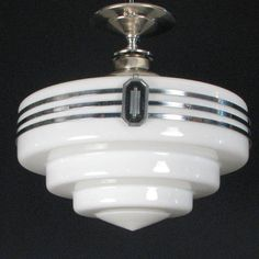 Art deco ceiling light. We have a similar repro in our kitchen.