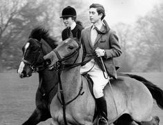 Princess Anne and Prince Charles riding horses