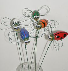 OMY I'm going to end up with a whole flower bed full of these cute little things :)  Garden stakes made from recycled christmas light bulbs and wire. This sample from Etsy. Also cute to use metal washers for eyes (wired on) and yellow Christmas bulb to make a lighting bug insect - DIY craft & crafting idea project.