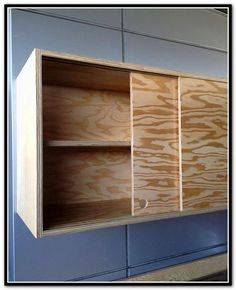 Sliding Cabinet Doors And Discreet Handles Keep The Piece