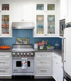 White cupboards with blue backsplash