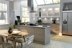 Wren Kitchens: Autograph Stone Grey Gloss Kitchen - The soft tone of this design creates a welcoming space, and the high gloss finish gives it plenty of style points! Practical and luxurious.