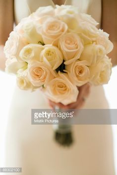 Cropped Bride Holding Rose Bouquet Stock Photo | Getty Images