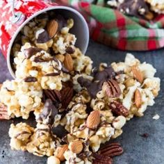 Caramel Moose Munch Fancy Popcorn is crunchy, sweet, and chocolatey, caramel corn sprinkled with three kinds of nuts, and drizzled in two types of chocolate Popcorn Recipes, Candy Recipes, Gourmet Recipes, Dessert Recipes, Cooking Recipes, Desserts, Snack Recipes, Flavored Popcorn, Top Recipes
