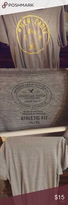 AmericanEagle Outfitters Men's XL Grey shirt with distressed yellow image of eagle and amer eagle 32210 div on front plain back, EUC. Athletic fit XL. Feel free to make offers and bundles get even better discounts ;) American Eagle Outfitters Shirts Tees - Short Sleeve