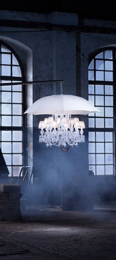 """Philippe Starck adds his quirky touch to this pretty chandelier - why? Makes for an interesting photo though"""