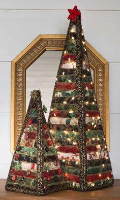 """Looking for easy Christmas gifts to make? This Christmas Trees Kit fits the bill. Decorate your house this winter with these beautiful stand-up Christmas trees. Wrap 2 1/2""""-wide strips of fabric around batting strips to create these stand-up trees. Kit has Carol McLeod's directions for 8 1/2""""- and 16""""-high trees, precut 2 1/2"""" strips by Hoffman, and a 25-yard roll of 2 1/2""""-wide cotton batting to make two trees, one large and one small."""