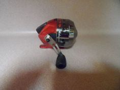 FISHING REEL, SHAKESPEARE REVERB .CLOSE FACE REEL, NEW.