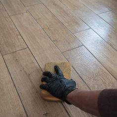 19824a50be Update an old kitchen floor with wood-look tile. It combines the durability  of tile with the beautiful appearance of hardwood. We ll show you how to  install ...