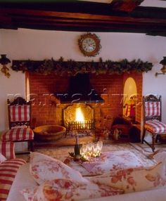 Country style cottage sitting room decorated for Christmas