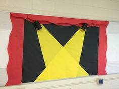 Hollywood movie theme classroom bulletin board. Can be used in variety of ways. Star student, a star is born for birthdays, book of month etc. cameras are made from black sparkly construction paper with yellow construction paper on inside. Curtains are bulletin paper but can be done with fabric.