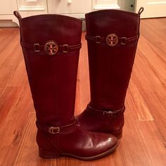 Tory Burch 'Calista' Riding Boots Beautiful Tory Burch brown riding boots with insignia on outer calf as well as a gold buckle on ankle. Worn a couple of times. Minimal wear. Splotch on right lower shin, very small (less than an inch), also very small scrape on right toe. These are both very small and unnoticeable. Left boot is pretty much perfect. See closet for more pics! Tory Burch Shoes Heeled Boots