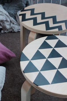 Cut-out black contact paper or vinyl stickers in geometric shapes can really transform Ikea's SVALSTA nesting tables.