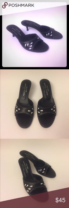 """Donald J Pliner Leather Slide Sandals Size 8.5 These Donald J Pliner leather slide sandals size 8.5 are in excellent pre-owned condition. The leather outer soles show normal wear, only worn handful of times. Very elegant and comfortable. Black leather upper with white accent; leather outer soles; heels are 2"""" high; style name Kiwi. Made in Italy Donald J. Pliner Shoes Sandals"""