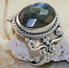Google Image Result for http://image.made-in-china.com/2f0j00ZKHadLjSntkQ/Fashion-Jewelry-Stainless-Steel-Gemstone-Cabochon-Ring.jpg