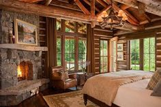 a cabin bedroom with a fireplace is so cozy