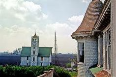 voorhies castle - Google Search This is a picture of the clock tower that once stood on The Voorhies Castle property. The Voorhies Castle is not a castle, but a Queen Anne style home. It can be  found south of the Piatt County, Illinois near the village of Bement, but technically  the home is located in the tiny village of Voorhies. It is currently being renovated. Check out the Haunted Decatur books for the spooky history of this home.