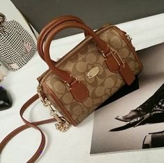 Authentic Coach Crossbody Satchel Detachable shoulder strap  Classic Coach monogram  Water repellent signature canvas fabric  Metal Coach emblem in front  Fully lined interior  Inner zipper compartment  Coach New York engraved hardware  Color:Brown/Gold   Dimensions:  7.75 inches (length) x 5.5 inches (height) x 3.4 inches (depth)   BRAND NEW  Retail $250 Coach Bags Crossbody Bags