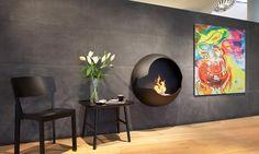 Il biocamino Cupola del marchio svedese Vauni è una soluzione molto raffinata per cambiare il vostro salotto in un interno accogliente e moderno.  Il design classico e pulito è senza dubbio il più grande vantaggo del modello Cupola. Il biocamin è molto compatto, il suo montaggio sul muro è semplice come la sospensione di un TV con lo schermo piatto. Il profilo è molto caratteristico, è fatto con un alluminio morbido. Grazie a questo materiale diventerà un elemento moderna nella vostra casa…