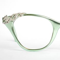 Vintage mint green Tura cat eye glasses.