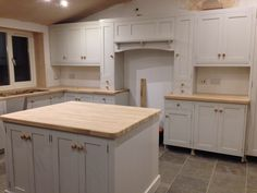 Kitchen (work in progress) from Pineland. Grey limestone tiles. Units Cornforth White. Oak worktops.